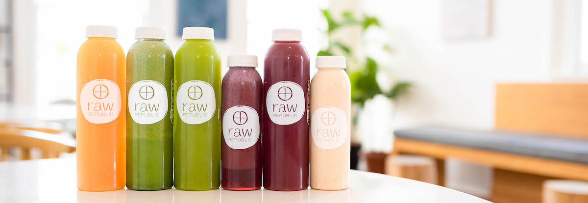 cold pressed juices lined up on counter